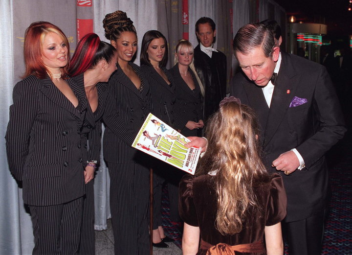 "The Spice Girls and Richard E. Grant wait to meet Prince Charles at the 1997 premiere of ""Spice World."""