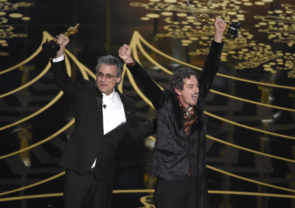 """Mark Mangini and David White accept the Best Sound Editing Oscar for """"Mad Max: Fury Road"""" inFebruary 2016."""