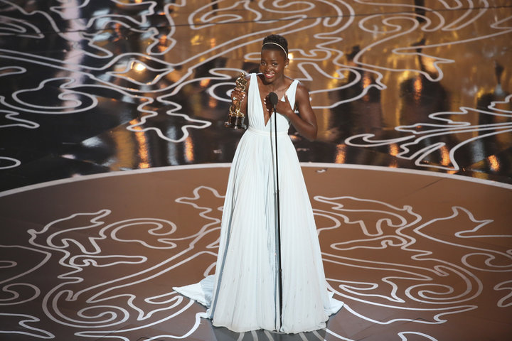 "Nyong'o accepting the Best Supporting Actress Oscar for ""12 Years a Slave"" in 2014."
