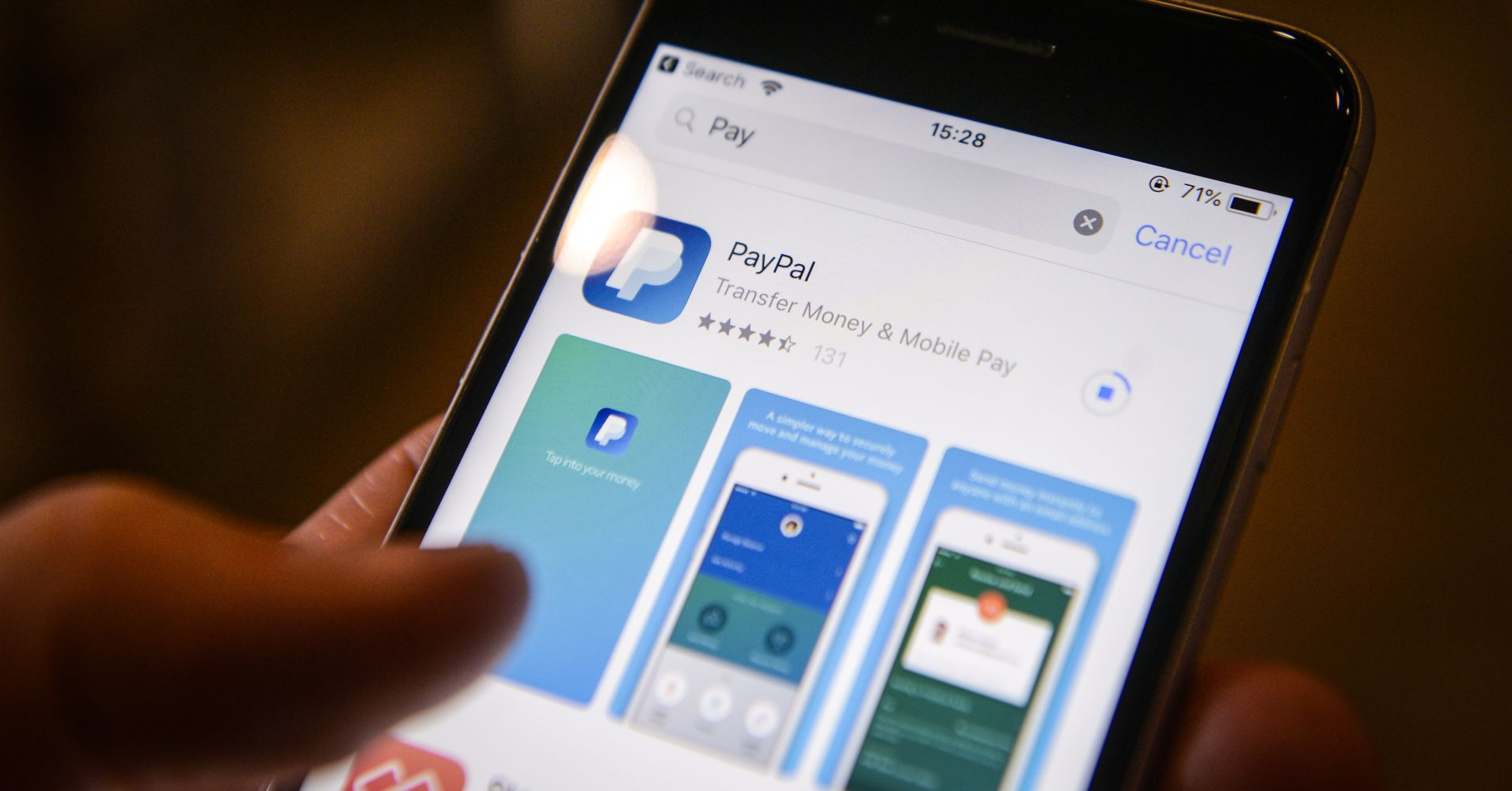 The PayPal application is seen on an iPhone