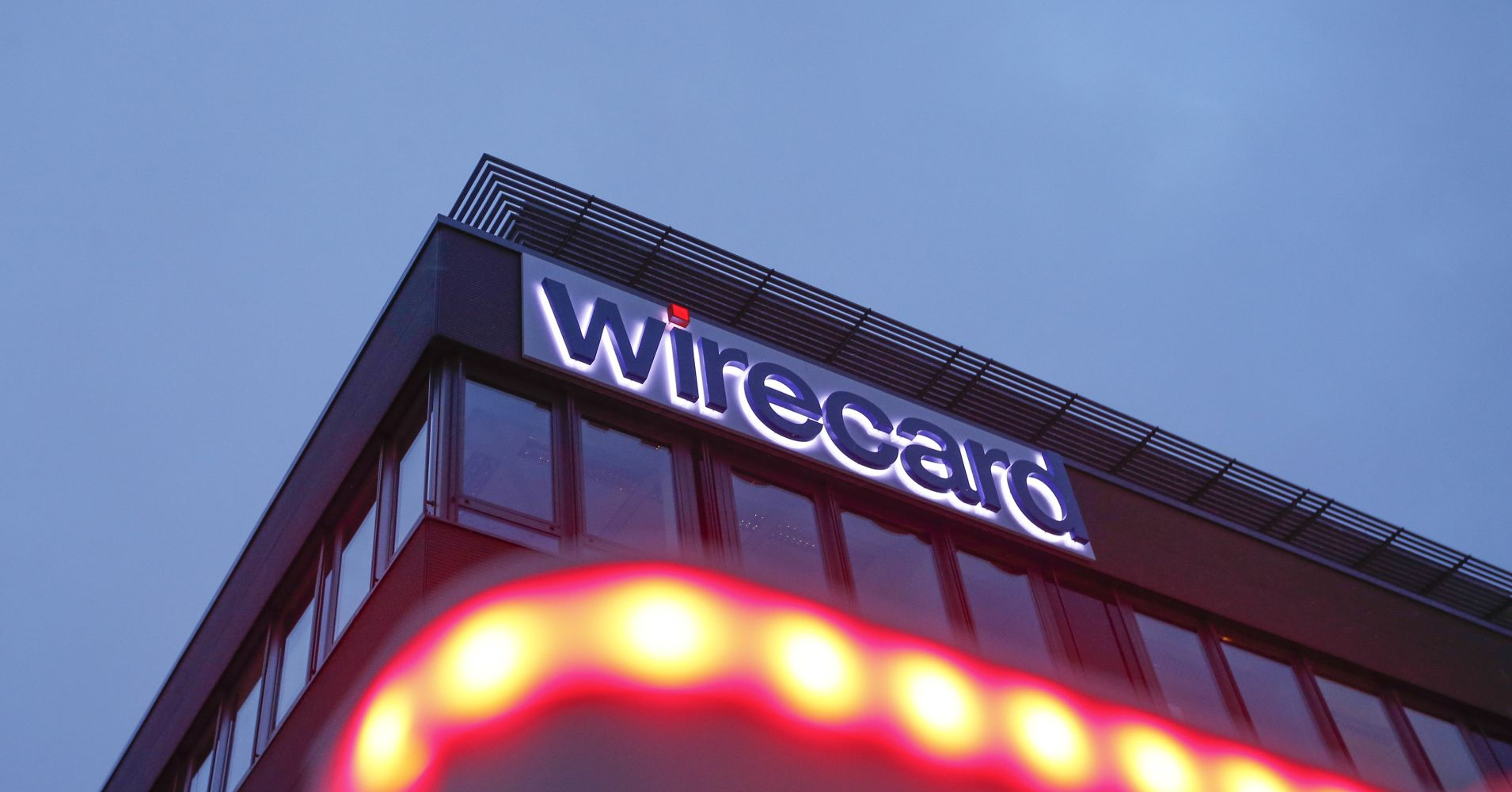 An illuminated logo sits on the exterior of Wirecard's headquarters in the Aschheim district of Munich, Germany.