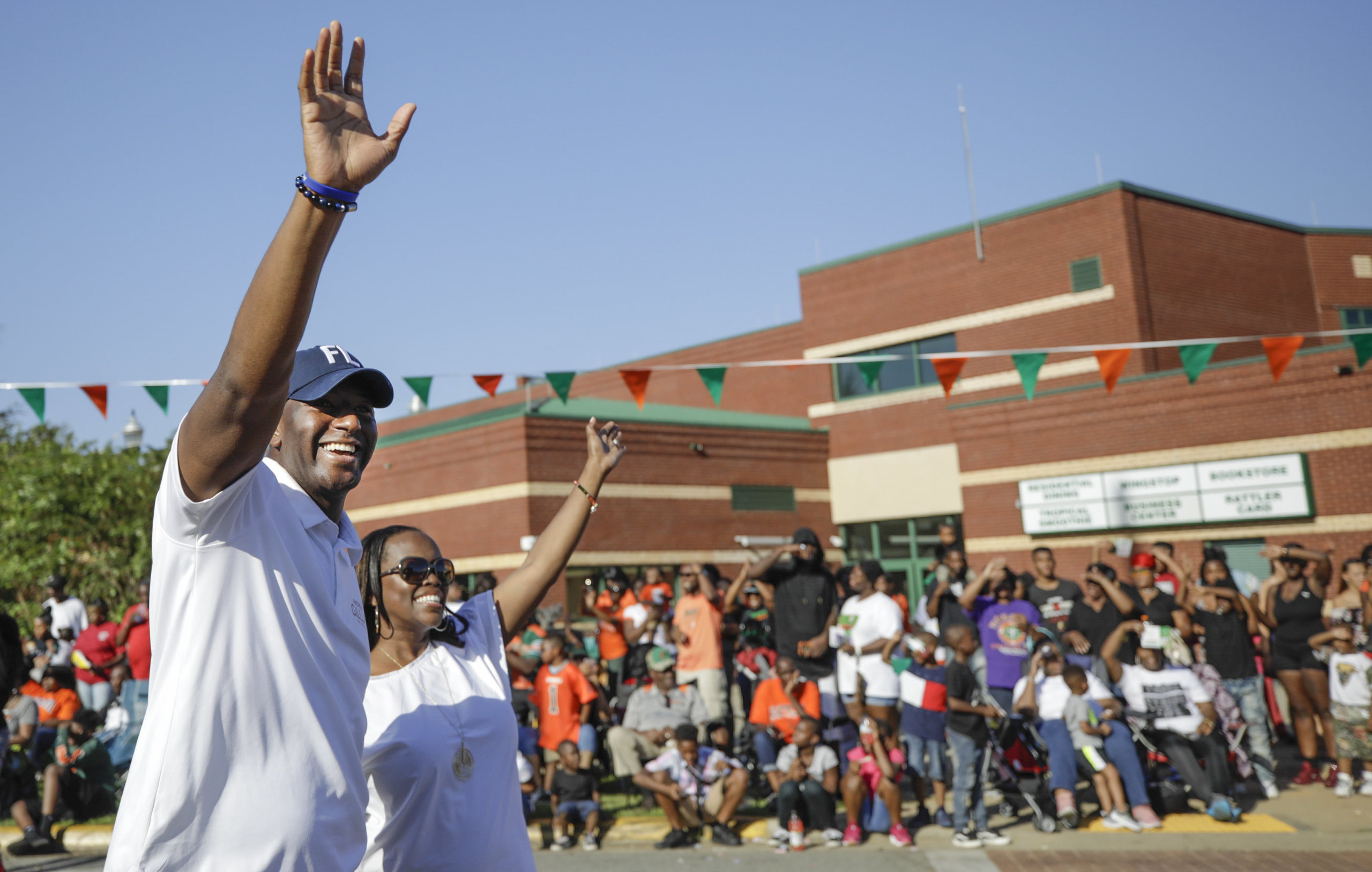 Andrew Gillum and his wife, R. Jai Gillum, at the FAMU homecoming parade.He's a Rattler, having graduated from th