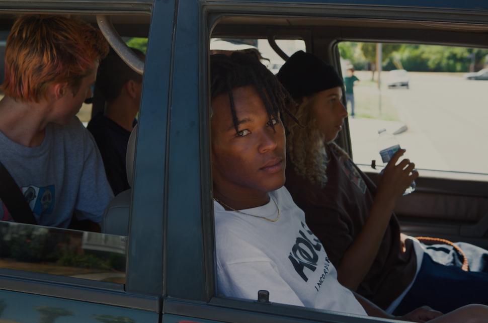 "Na-kel Smith, who plays Ray, stares out from a car during the making of ""Mid90s."""