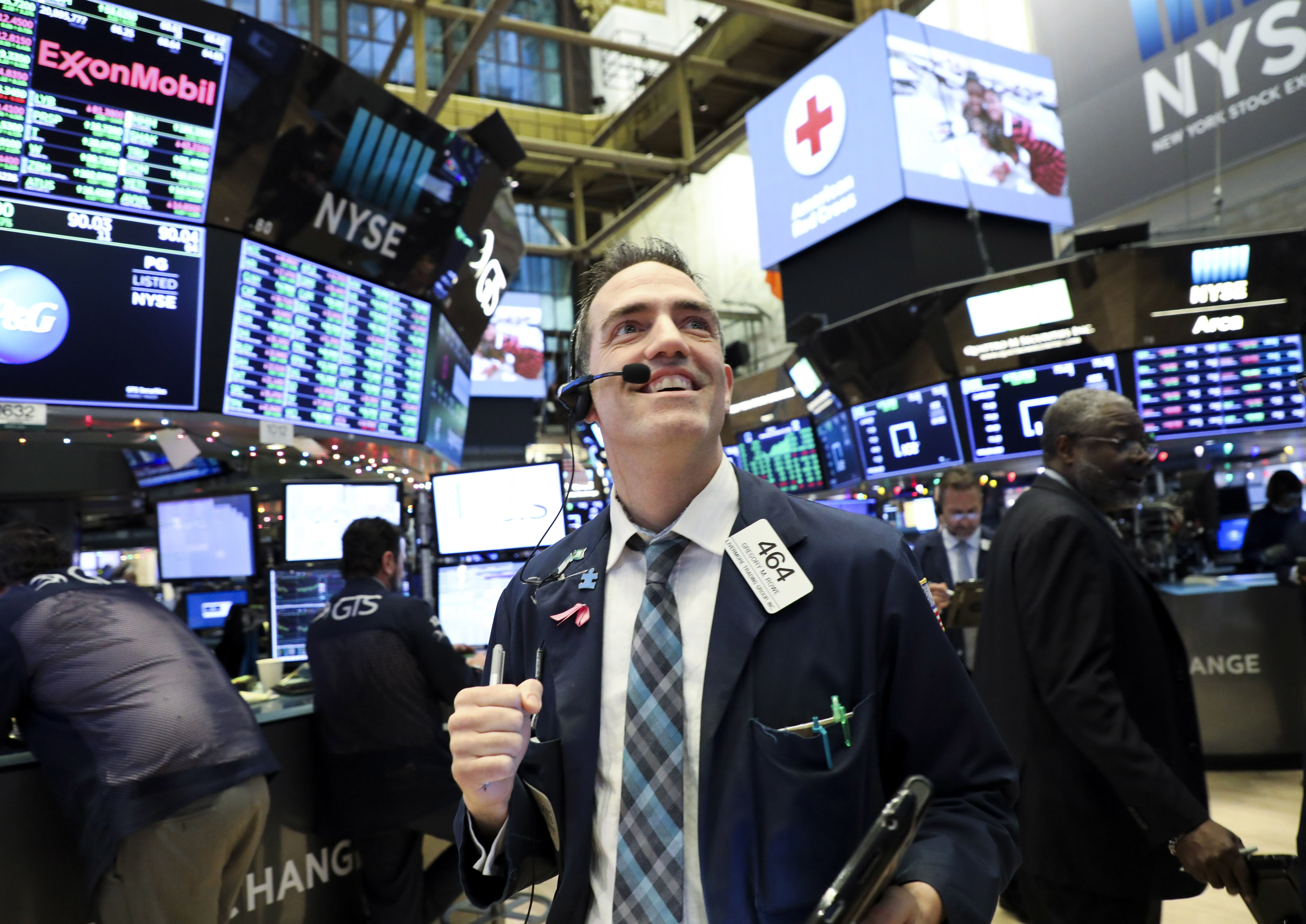 Traders work at the New York Stock Exchange in New York, the United States.