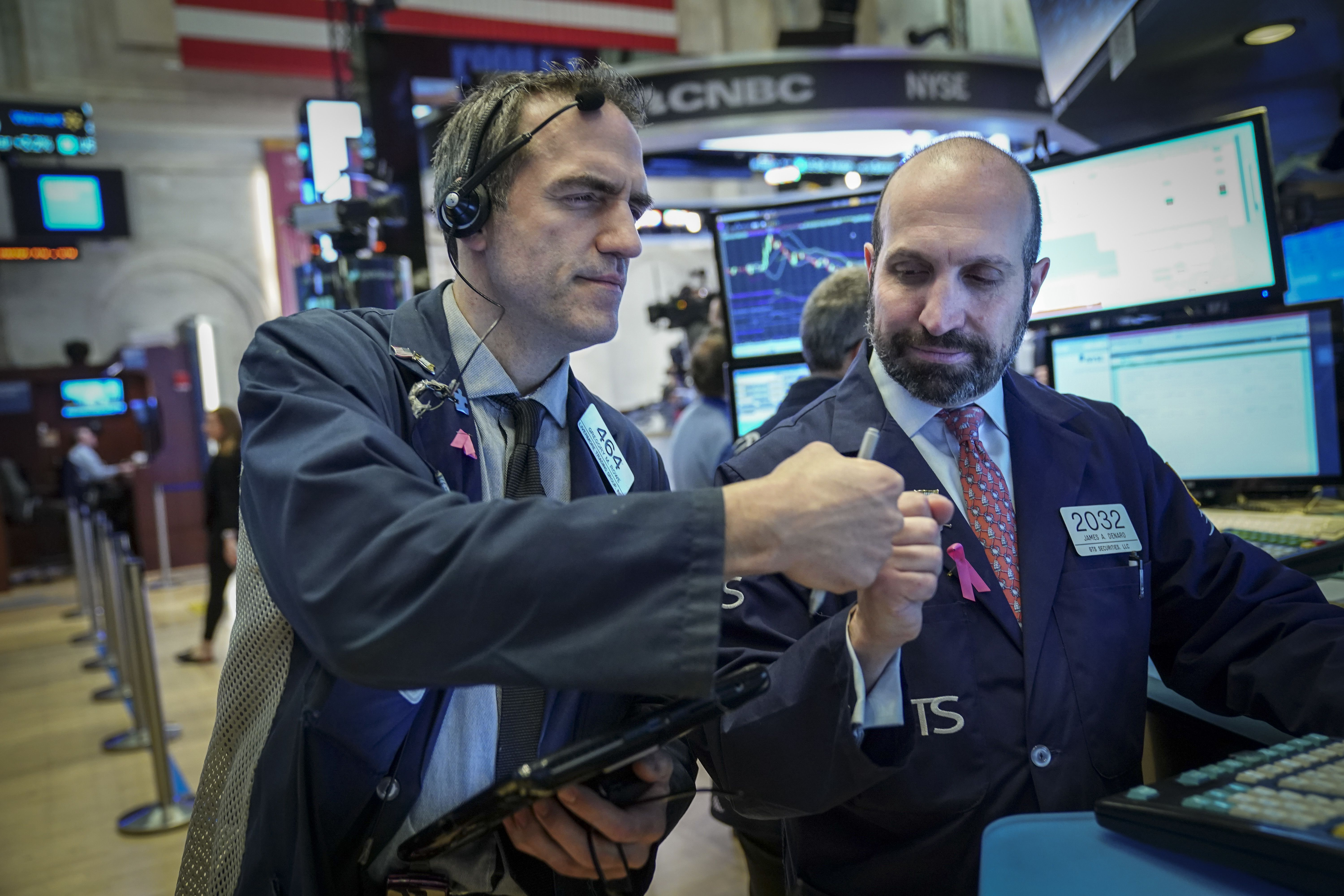 Traders and financial professionals work on the floor of the New York Stock Exchange (NYSE) ahead of the opening bell, January 4, 2019 in New York City.