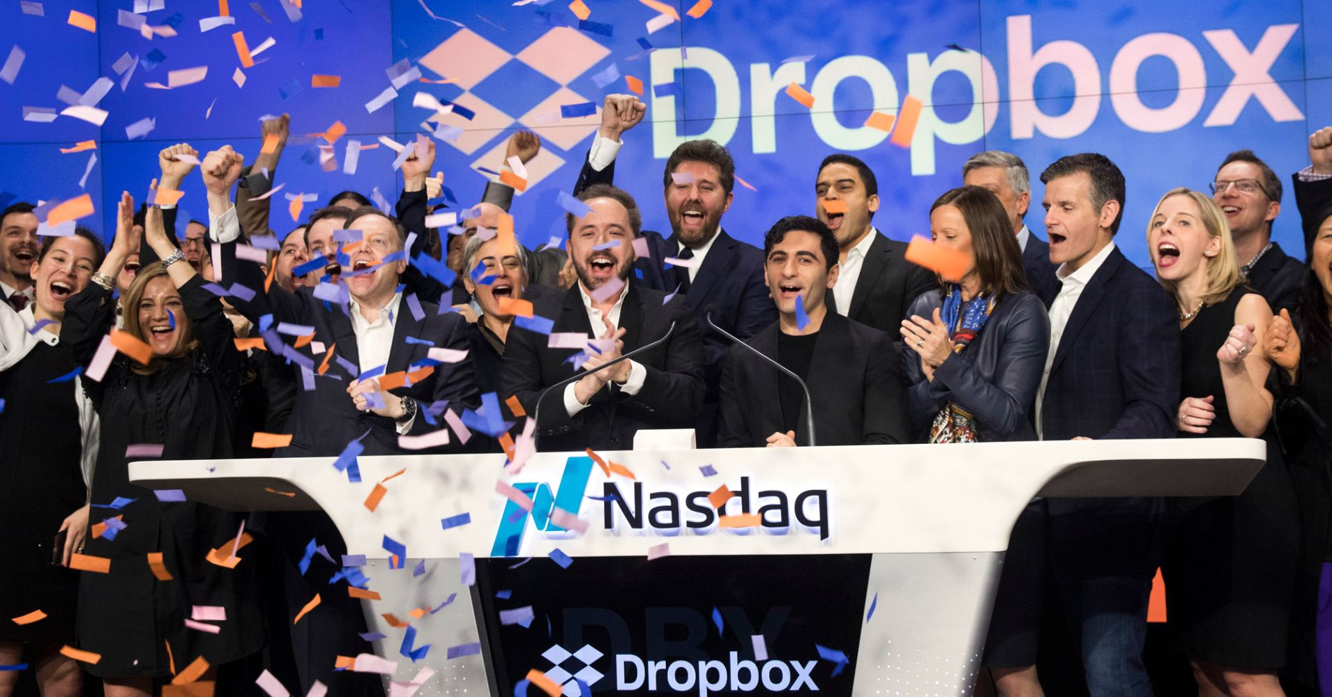 Dropbox CEO Drew Houston and Dropbox co-founder Arash Ferdowsi (C) celebrate the launch of Dropbox's initial public offering as they ring the opening bell at Nasdaq MarketSite, March 23, 2018 in New York City.