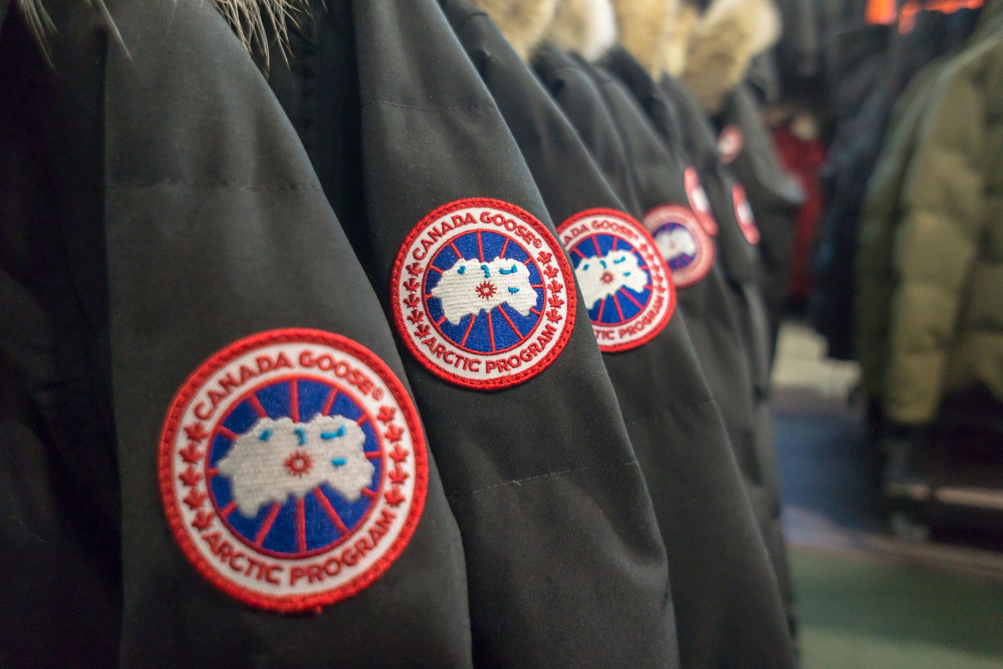 Stocks making the biggest moves midday: Canada Goose, Capri Holdings