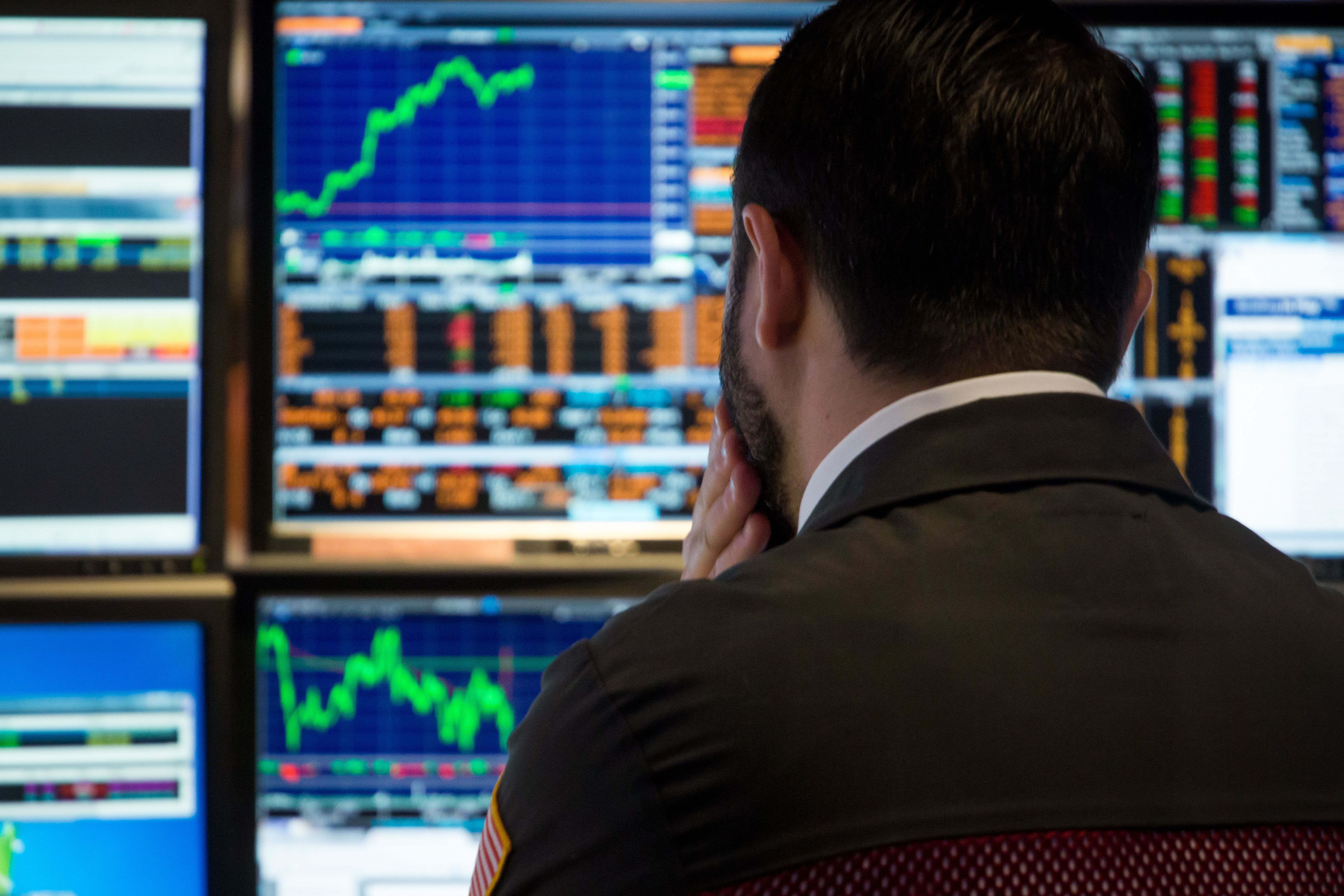 A trader looks at price monitors as he works on the floor at the New York Stock Exchange in New York City, December 4, 2018.