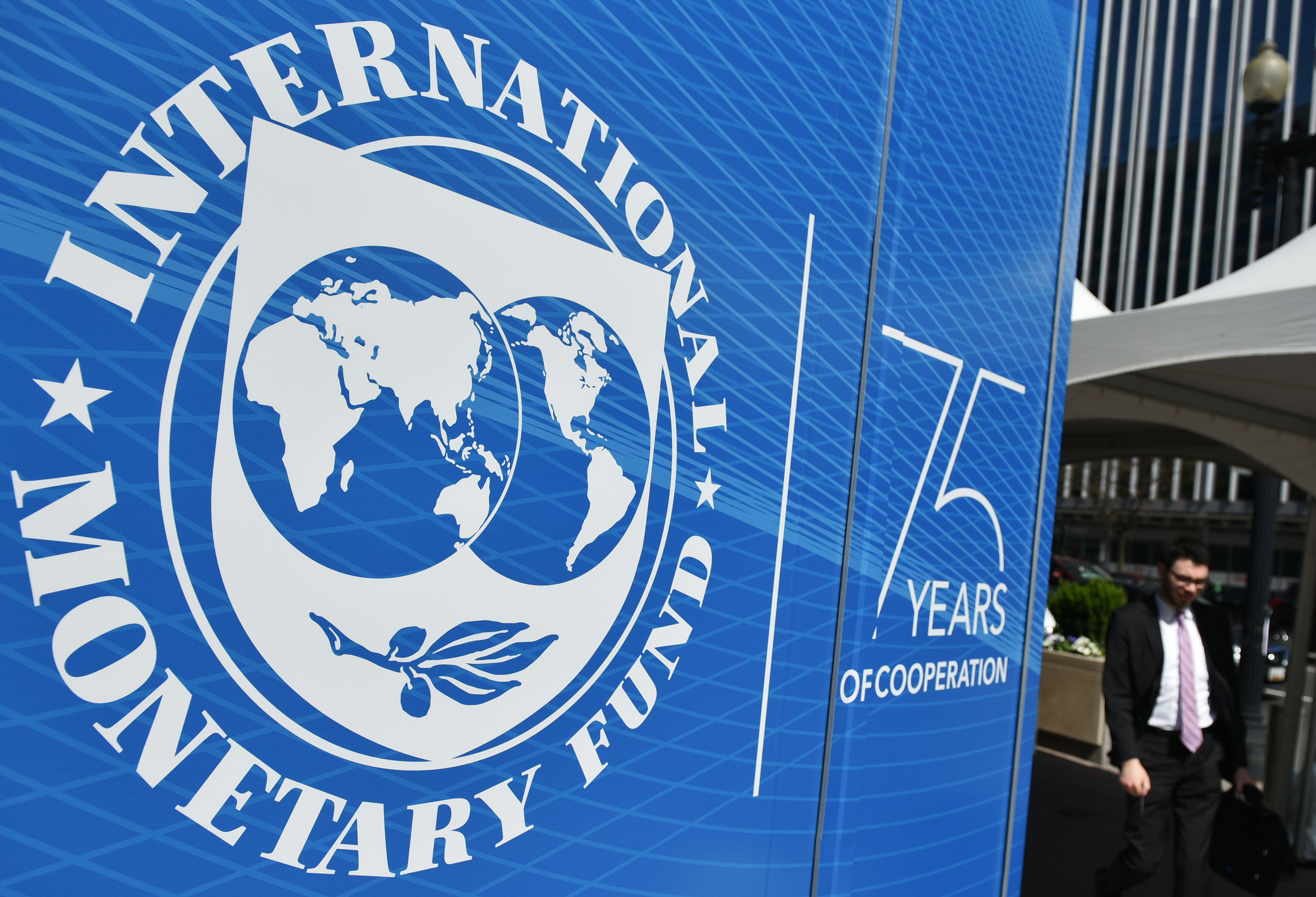 IMF lowers its global economic growth forecast again as risks remain to the 'downside'