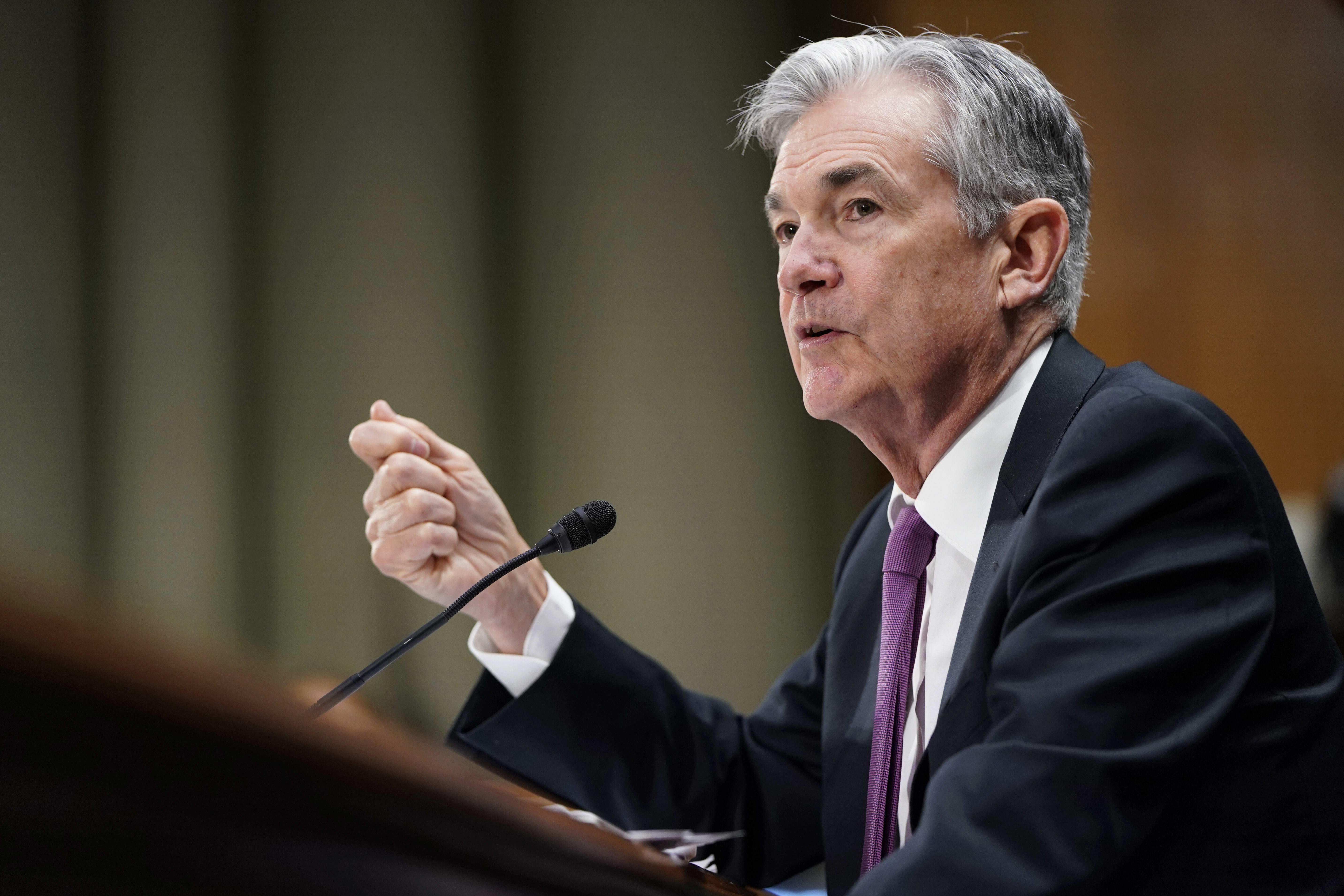 Powell says the Fed may have to resume balance sheet growth