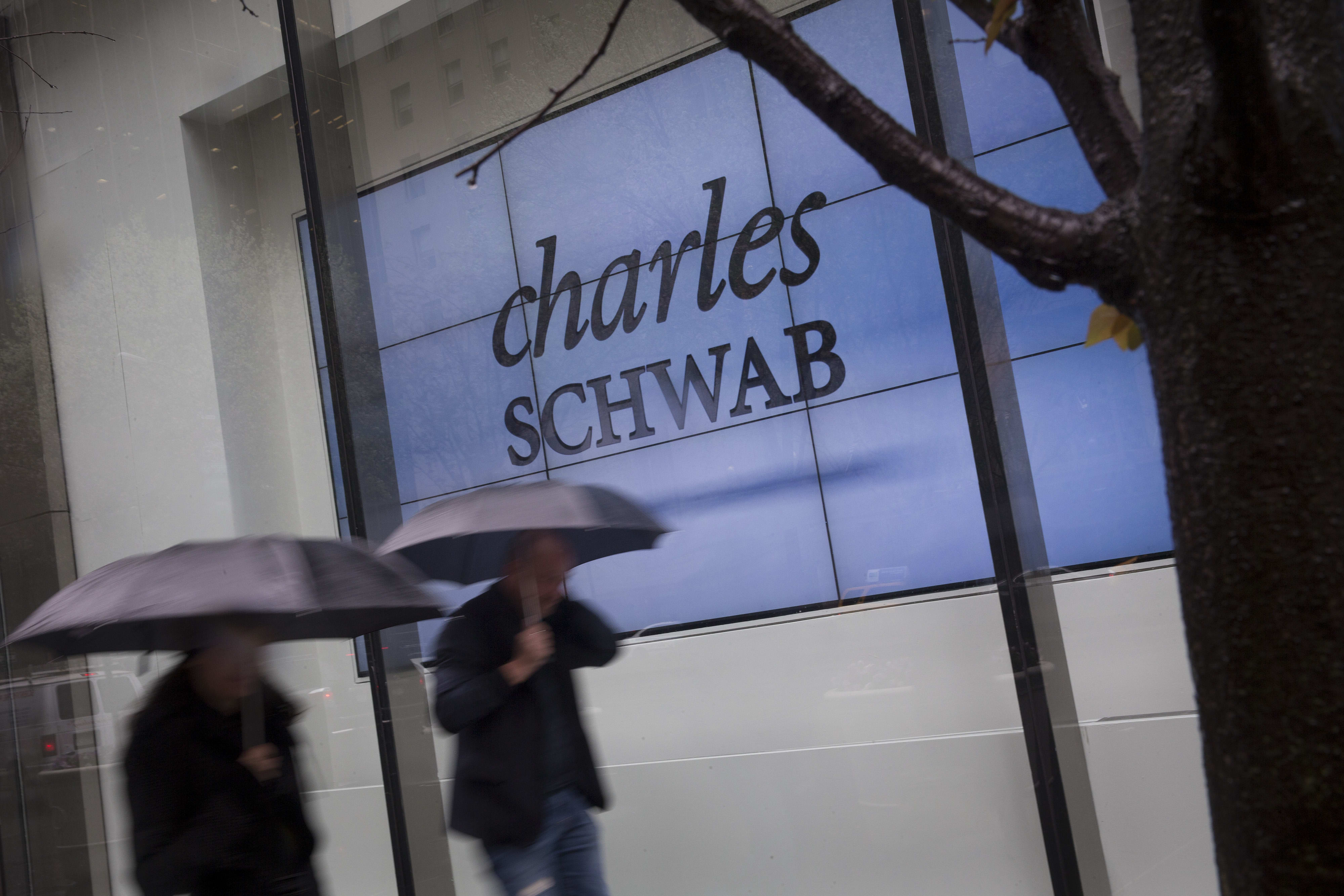 Schwab is laying off 600 employees amid hit from the Fed's interest rate cuts