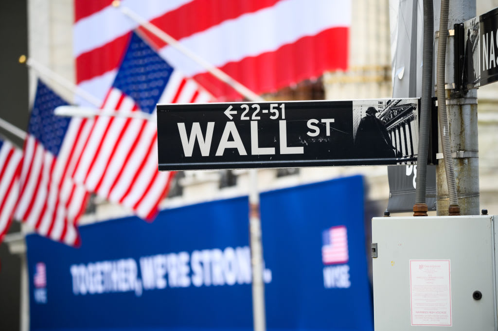 Divided market, tech leads Nasdaq to record, Dow down 200