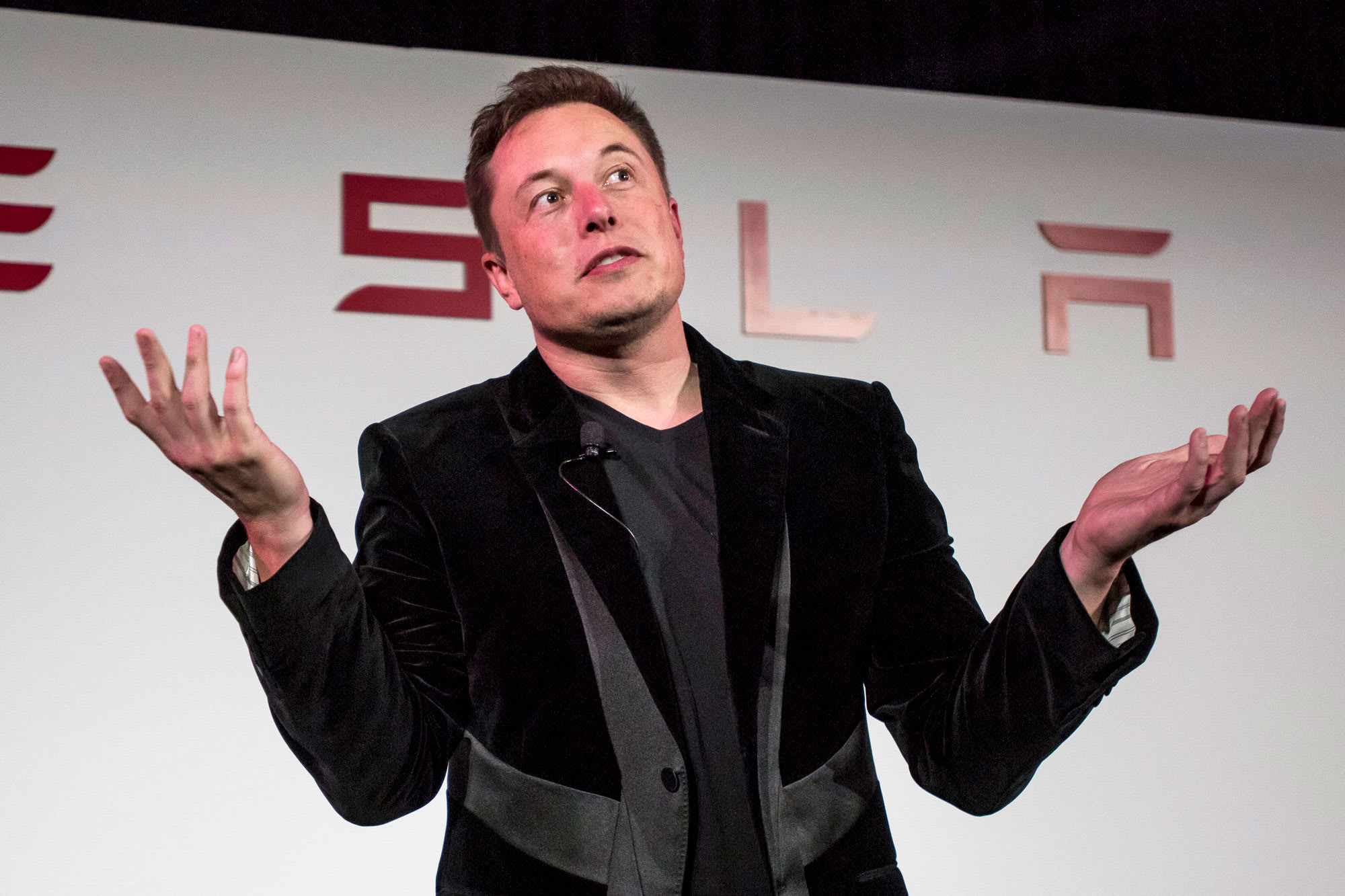 Tesla gives up 16% pop to close negative in wild speculative trading