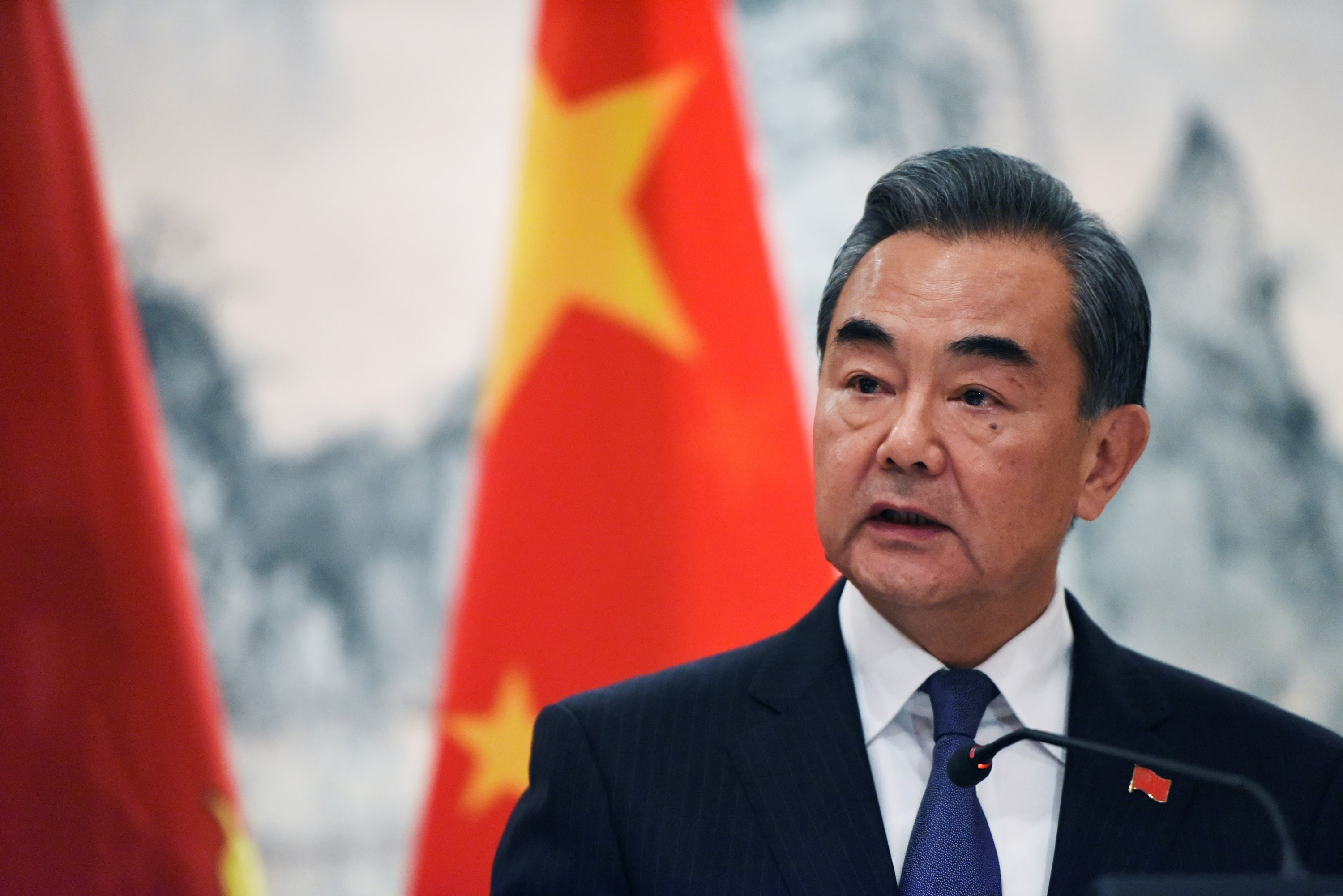 Top Chinese diplomats give conciliatory signals while demanding respect from the U.S.
