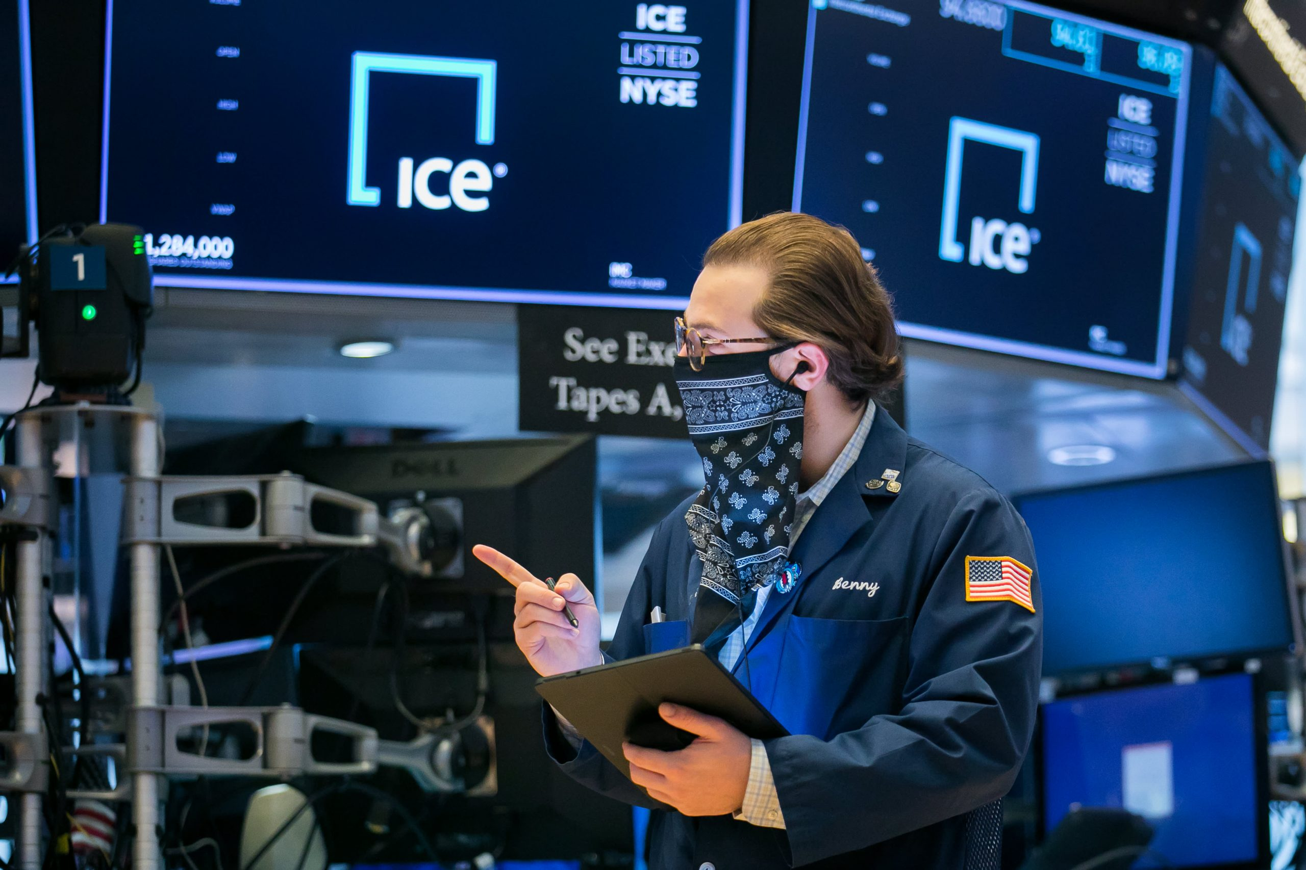 Dow futures fall more than 200 points as fresh virus restrictions raise concerns about recovery