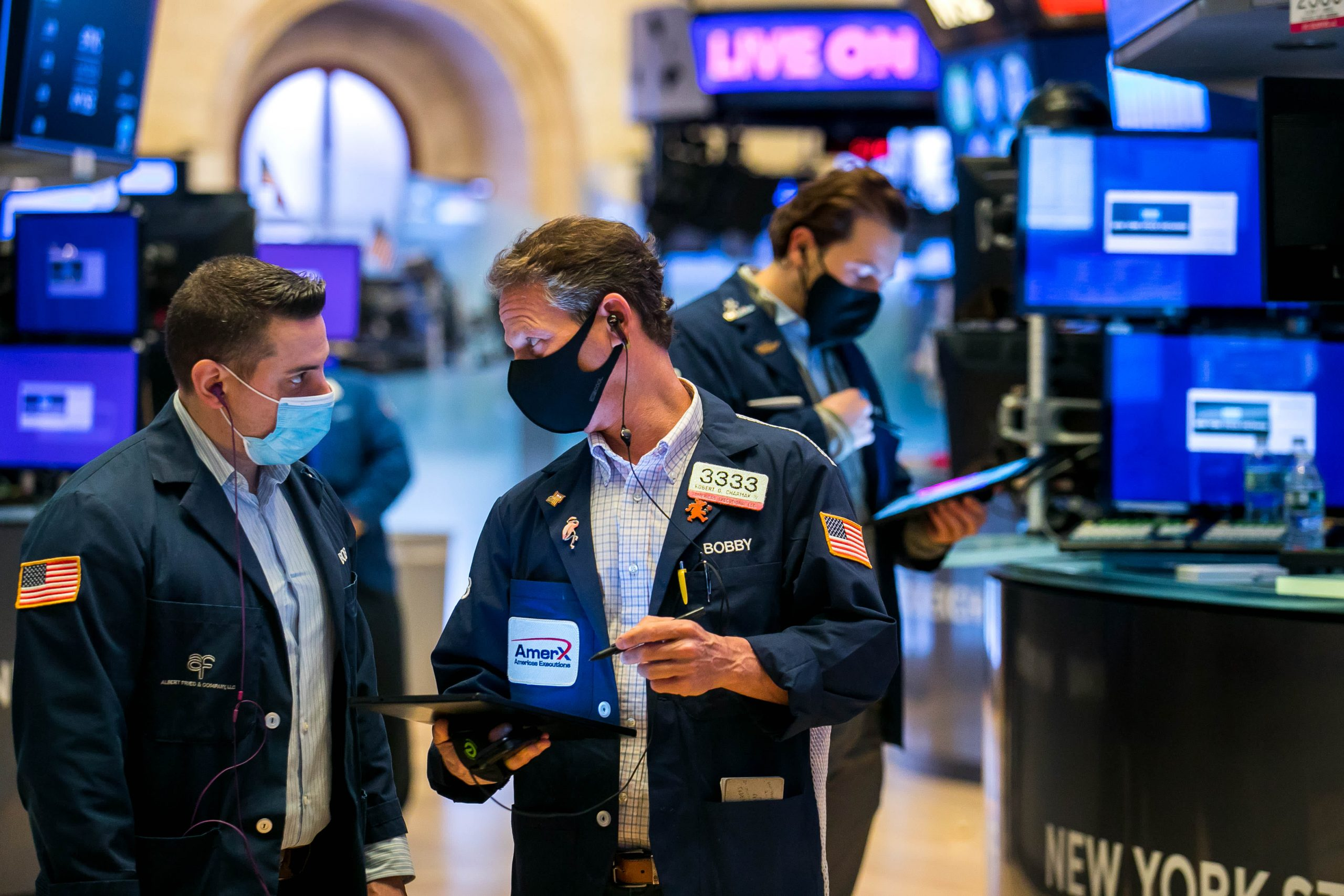 Stock futures lower after major averages close at record highs