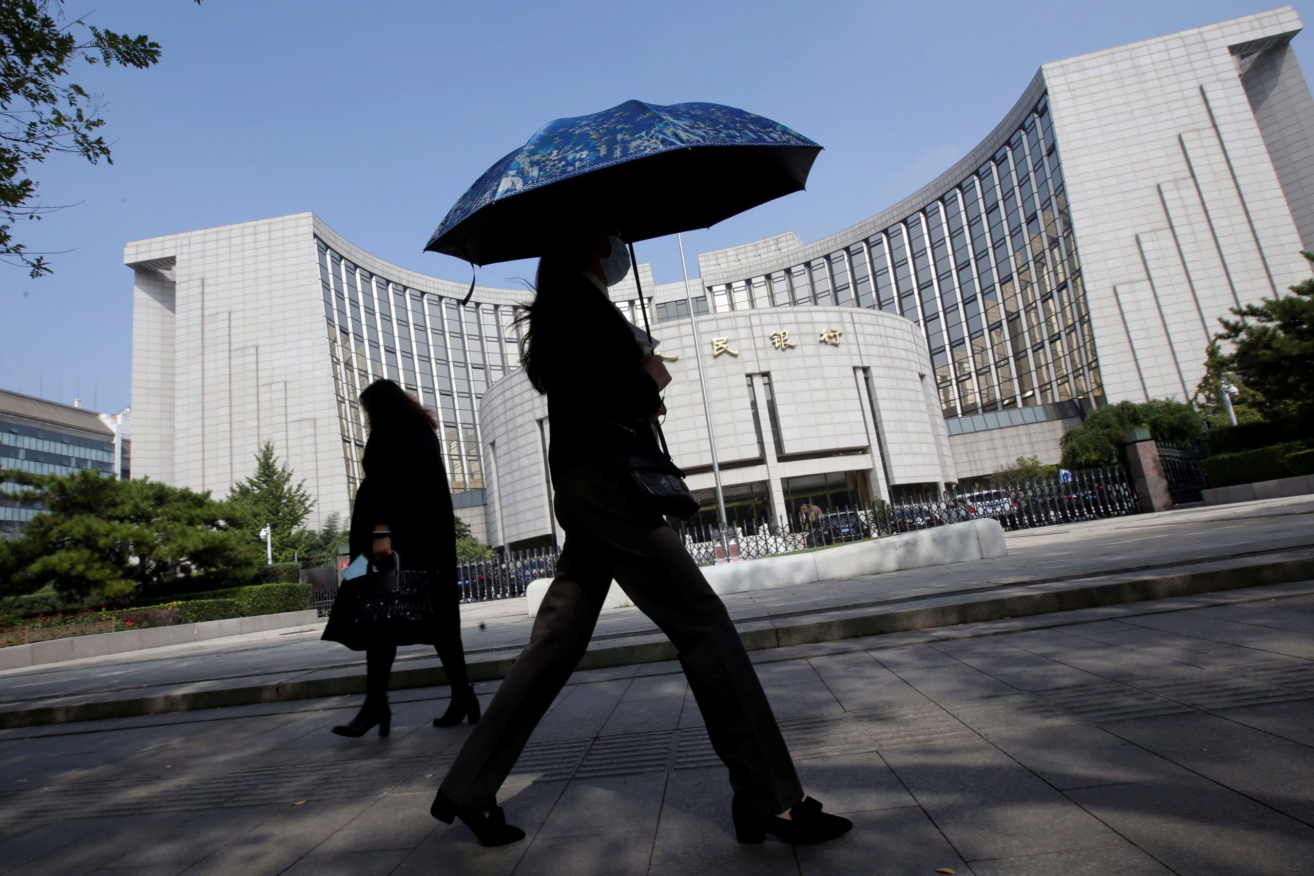 China's central bank warns of financial risks, including potential defaults