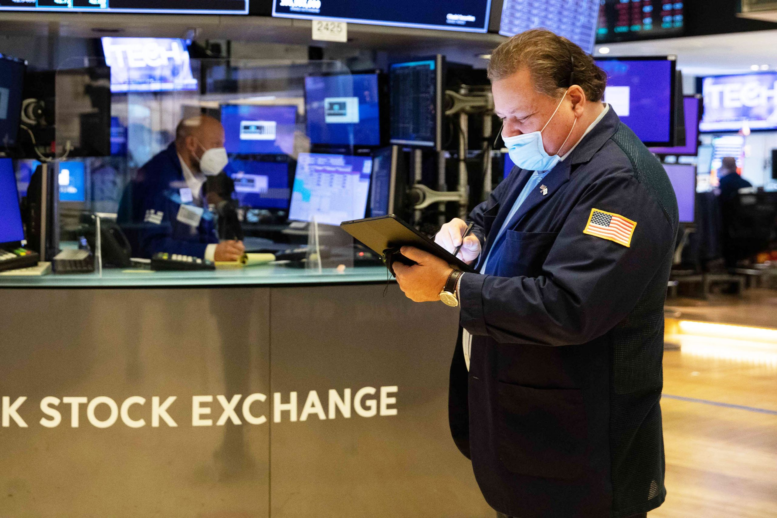 Stock futures are flat in overnight trading after Dow closes above 34,000 for the first time