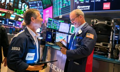 Dow rises 200 points to a record despite disappointing economic data